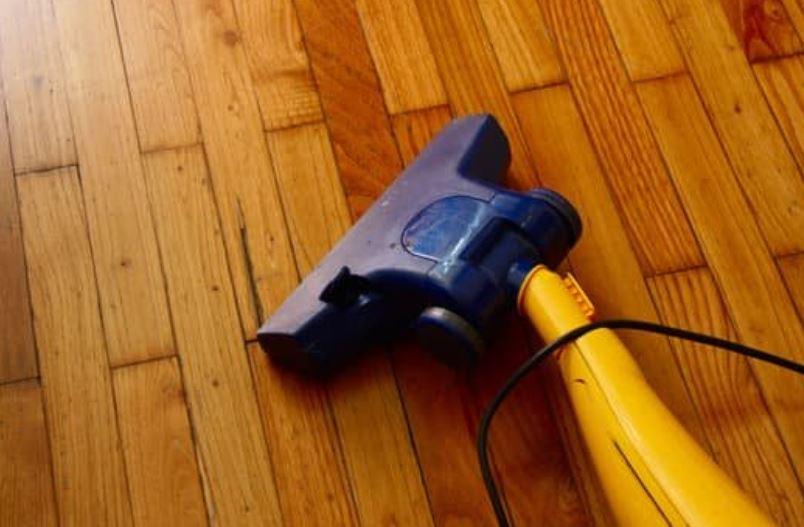 Clean engineered hardwood floors daily.